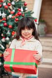 Cute Girl Holding Gift Royalty Free Stock Photo
