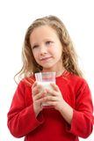 Cute girl holding glass of milk. Stock Images