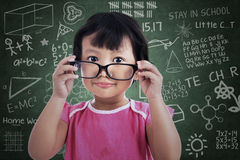 Cute girl holding glasses at class Royalty Free Stock Images