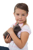 Cute girl holding grey kitten smiling at camera Stock Images