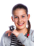 Cute girl holding a hamster Royalty Free Stock Photo