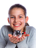 Cute girl holding a hamster Stock Photography