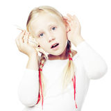 Cute girl holding hand on his ear Royalty Free Stock Photography