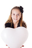 Cute girl holding heart shaped balloon Stock Photos