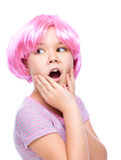 Cute girl is holding her face in astonishment Royalty Free Stock Image