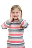 Cute girl is holding her face in astonishment and looking up, isolated over white Royalty Free Stock Images