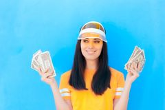 Cute Girl Holding Her Money Savings in Dollar Banknotes. Young woman with lots of cash planning financial future royalty free stock photography