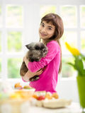 Cute girl holding her rabbit Royalty Free Stock Photos