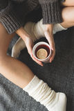 Cute girl holding hot tea Royalty Free Stock Photo