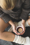 Cute girl holding hot tea Royalty Free Stock Photography