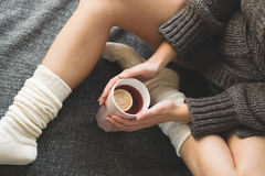 Cute girl holding hot tea Stock Image