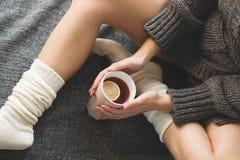 Cute girl holding hot tea Stock Image