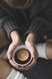 Cute girl holding hot tea Royalty Free Stock Image