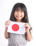 Cute girl holding Japanese Flag Royalty Free Stock Images
