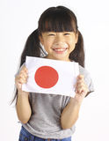 Cute girl holding Japanese Flag Royalty Free Stock Photos