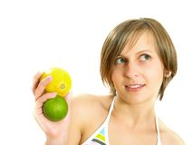 Cute girl holding lemon and lime Stock Photos