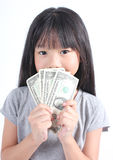 Cute girl holding money Royalty Free Stock Photos