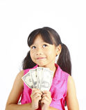 Cute girl holding money. Royalty Free Stock Photography