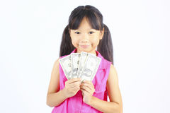 Cute girl holding money. Royalty Free Stock Image