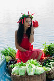 Cute girl holding a pepper Royalty Free Stock Images