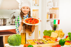 Cute girl holding plate with tasty pizza Stock Photo