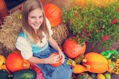 Girl with a pumpkin stock photos