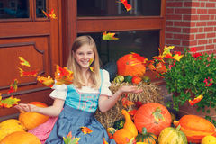 Girl with a pumpkin royalty free stock photography