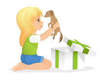 Cute girl holding a puppy Stock Images