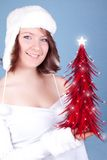 Cute  girl holding a red xmas tree Royalty Free Stock Photo