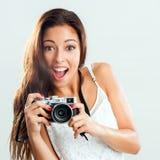 Cute girl holding retro camera. Royalty Free Stock Photo