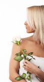 Cute girl holding a rose royalty free stock image