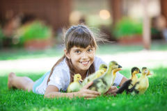 Cute girl  holding spring ducklings Royalty Free Stock Photos