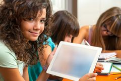 Cute girl holding tablet with copy space.