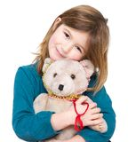Cute girl holding teddy bear. Close up portrait of a cute girl holding teddy bear on isolated white background Stock Images