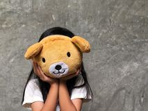 Cute girl holding teddy bear. Fun time playing with a doll Royalty Free Stock Photos