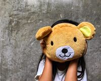 Cute girl holding teddy bear. Fun time playing with a doll Stock Photos