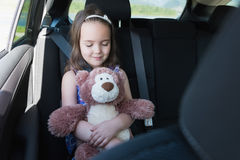 Cute girl holding teddy bear while sleeping Royalty Free Stock Photography