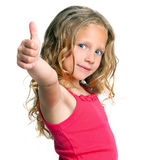 Cute girl holding thumbs up. Close up portrait of cute girl showing thumbs up.Isolated on white Royalty Free Stock Photos