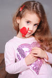 Cute girl holding valentine's heart Royalty Free Stock Photos