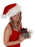 Cute girl holding xmas gift stock images