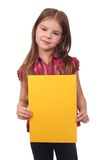 Cute girl holding yellow blank Royalty Free Stock Images