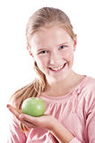 Girl with green apple Royalty Free Stock Photography