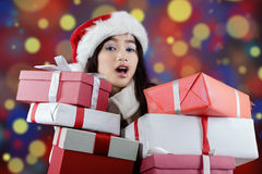 Cute girl holds presents with christmas background Royalty Free Stock Images
