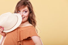 Cute girl holds summer straw hat covering her face Royalty Free Stock Photography
