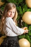 Cute girl at home with christmas tree. Royalty Free Stock Photography