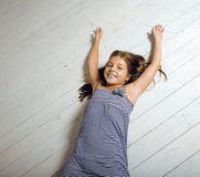 Cute girl at home. Laying on floor messed hair Royalty Free Stock Photos