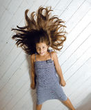 Cute girl at home. Laying on floor messed hair Royalty Free Stock Photo