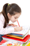 Cute girl homework writing Stock Images