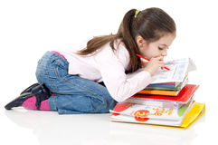 Cute girl homework writing Stock Image