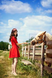 Cute girl with horse Stock Photo